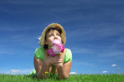 Girl Enjoying Summer Flowers