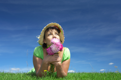 Girl in a Field with Flowers